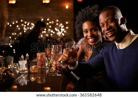 Portrait Of Couple Enjoying Night Out At Cocktail Bar - stock photo