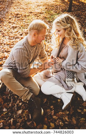 portrait of couple in autumn on nature, love