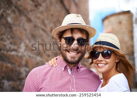 Portrait of couple in hats and sunglasses - stock photo