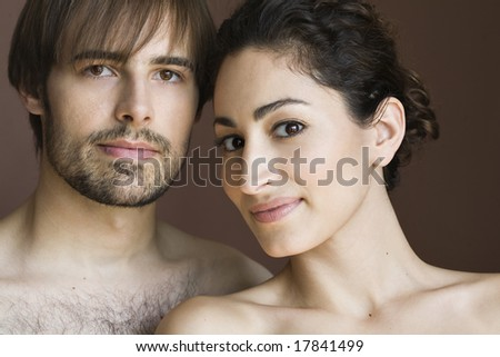 Portrait of couple in studio - stock photo