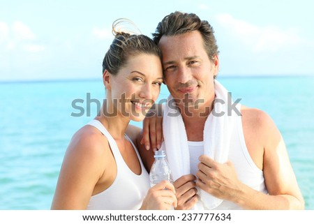 Portrait of couple looking at camera after exercising - stock photo