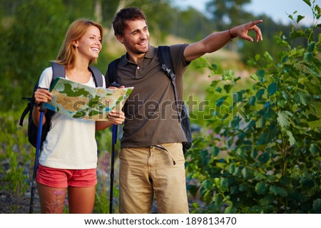 Portrait of couple of hikers in the countryside at summer - stock photo