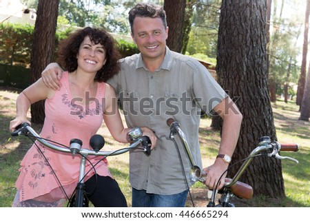 Portrait of couple on cycle ride through park