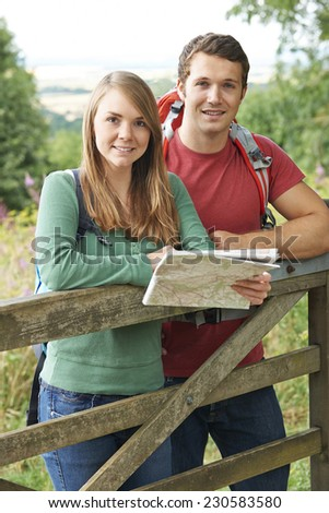 Portrait Of Couple On Hike In Countryside With Map - stock photo