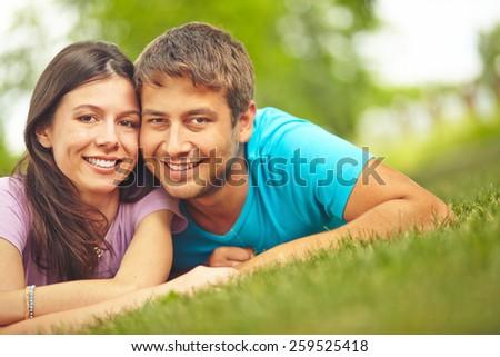 Portrait of couple on lawn - stock photo