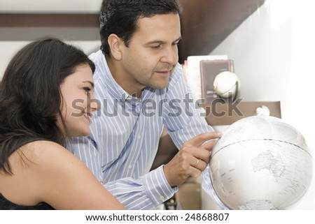 Portrait of couple planning vacation with map