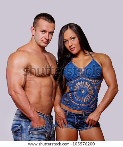 Portrait of couple posing in gym - stock photo