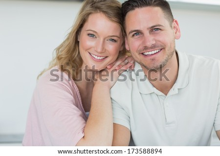 Portrait of couple smiling in kitchen