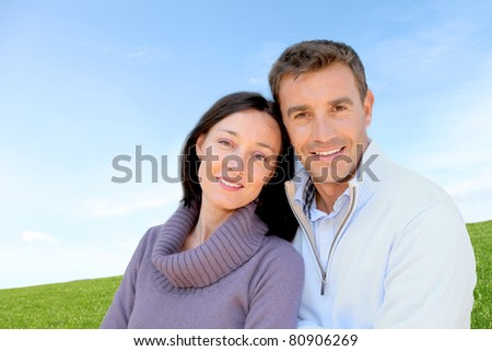 Portrait of couple standing outside