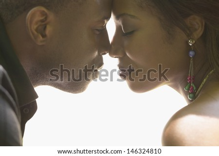 Portrait of couple touching noses - stock photo