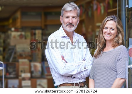 Portrait Of Couple Who Own Bookshop Outside Store - stock photo