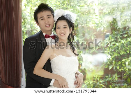 portrait of couples of asian groom and bride in wedding suit - stock photo