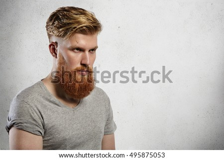 Portrait Of Courageous And Fashionable Male Model With Long Trendy Beard  And Undercut Hairstyle. Caucasian