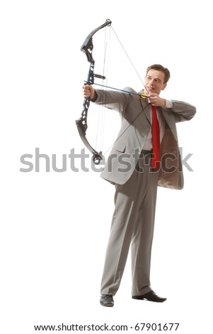 Portrait of courageous businessman holding crossbow and aiming at target