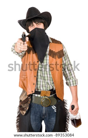 Portrait of cowboy with a gun and bottle of whiskey in hands