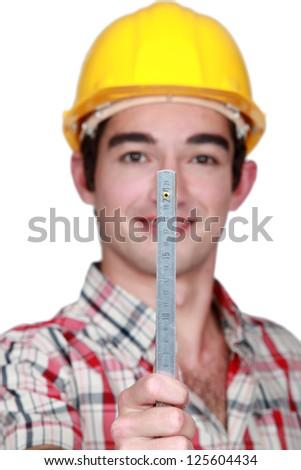 portrait of craftsman holding ruler - stock photo