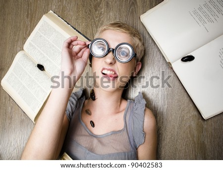portrait of crazy student in glasses with books and cockroaches