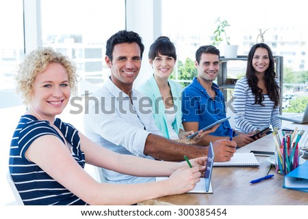 Portrait of creative business team in meeting at office