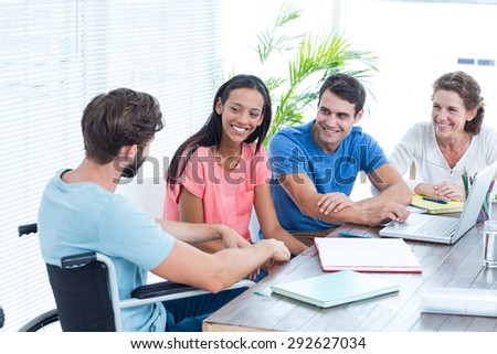 Portrait of creative business team in the office - stock photo