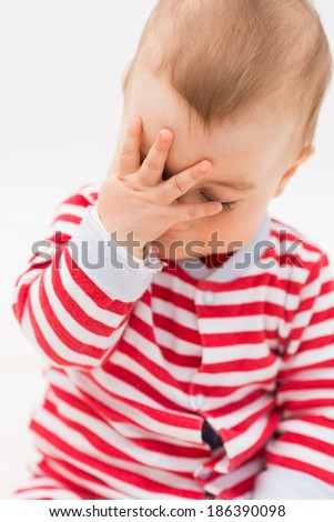 Portrait of crying baby boy with hands up - stock photo