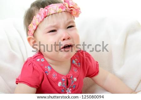 portrait of crying baby girl - stock photo