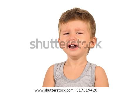 Portrait of crying little boy isolated on white background - stock photo