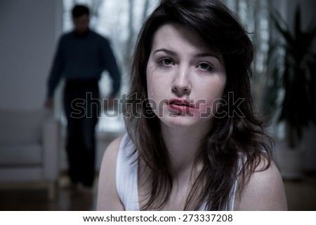 Portrait of crying woman with smudged makeup - stock photo
