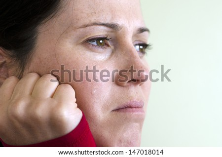 Portrait of crying young woman - concept photo - stock photo