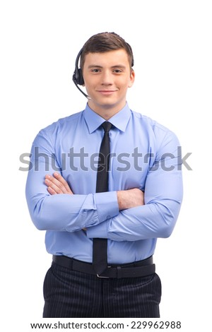 Portrait of customer service representative standing arms crossed. man with headset standing over white background - stock photo