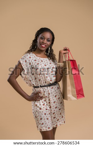Portrait of cute african woman posing - shopping with bags - stock photo