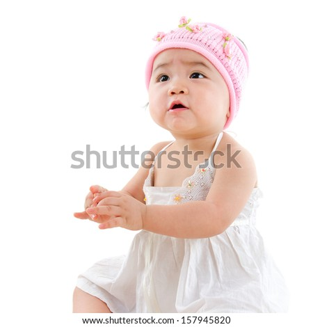 Portrait of cute Asian baby girl looking up,  isolated on white background - stock photo