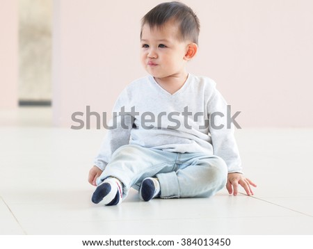 portrait of cute Asian baby with expression.