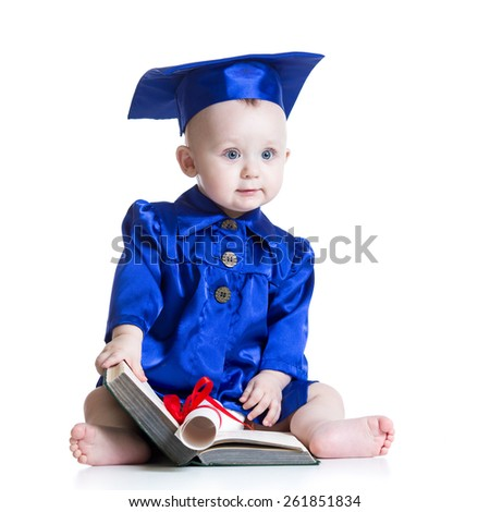 Portrait of cute baby boy in student hat with book - stock photo