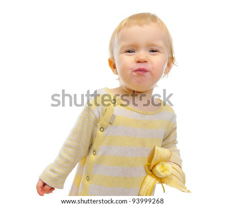 Portrait of cute baby eating banana isolated on white