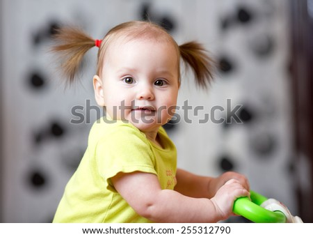 portrait of cute baby girl at home - stock photo