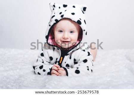 Portrait of Cute baby girl, one year old, close-up in studio - stock photo