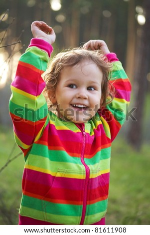portrait of cute baby girl playing in the park - stock photo