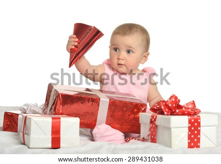 Portrait of Cute baby girl sitting  with gifts - stock photo