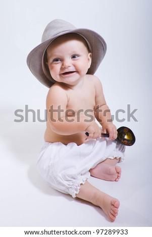 Portrait of cute baby in a big hat on a white studio background - stock photo