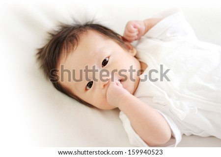 Portrait of cute baby in bed