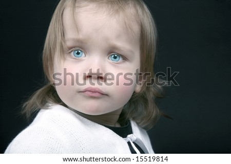 Portrait of cute baby who is a little scared, isolated