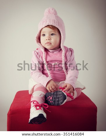Portrait of cute baby with pink woolen hat