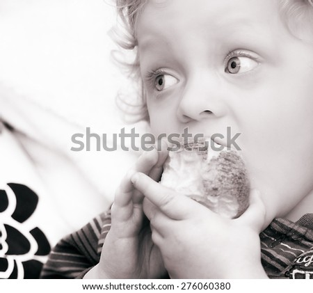 Portrait of Cute Blond Boy  with apple in black white - stock photo