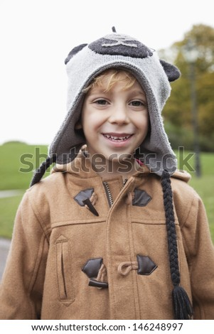 Portrait of cute boy in winter clothing at park