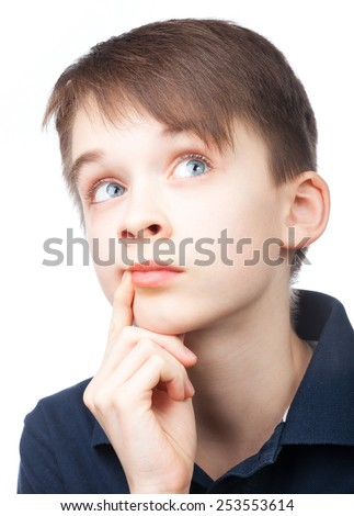 Portrait of cute boy looking up on white background - stock photo