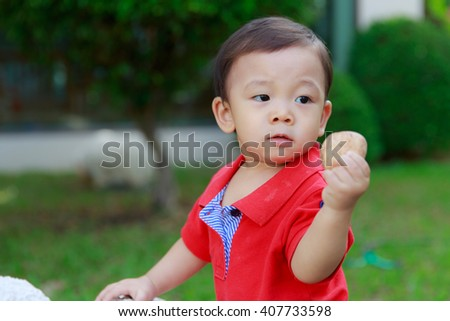 Portrait of cute boy playing pebble, outdoor - stock photo