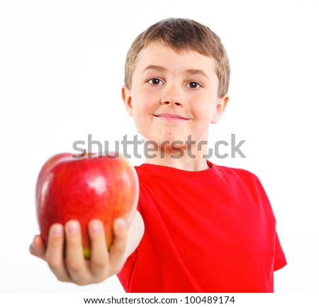 Portrait of cute boy with apple. Focus on the apple. Isolated on white background. - stock photo