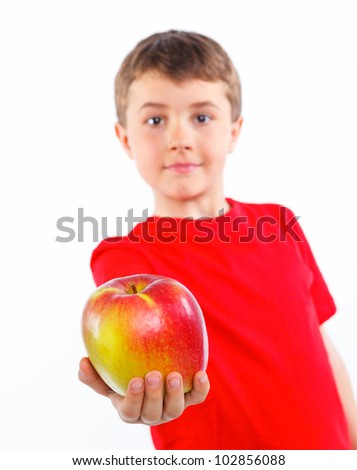 Portrait of cute boy with apple. Fokus on the apple. Isolated on white background. - stock photo