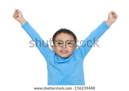 portrait of cute boy with blue shirt gesturing with his arms - stock photo