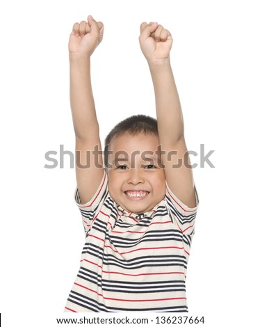 portrait of cute boy with green shirt gesturing with his arms - stock photo